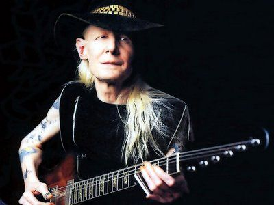 Johnny Winter performing solo on stage
